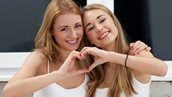 girls forming heart with their hands