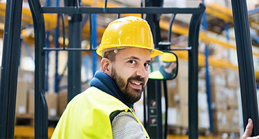 Man with a yellow hard hat on smiling
